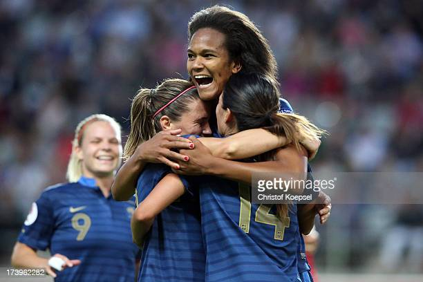 Wendine Renard of France celebrates the third goal with Camille Abily anc Louisa Necib of France during the UEFA Women's EURO 2013 Group C match...