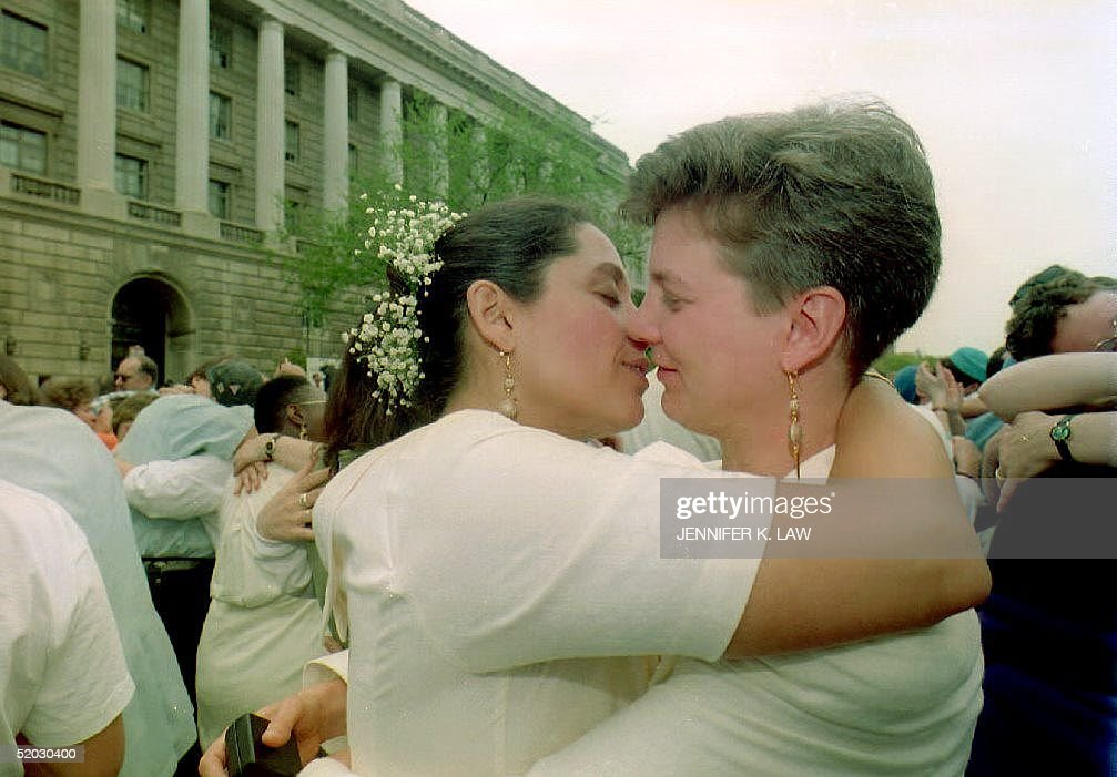 Wendy Benner-Leon (R) and Terri Leon-Benner (L), from Boston, embrace 24 April 1993 after exchanging wedding vows at an Interfaith Ceremony of Commitment in front of the Internal Revenue Service Building. The gay and lesbian wedding ceremony, which included several couples, was a demonstration for same-sex couples' rights under U.S. tax law.