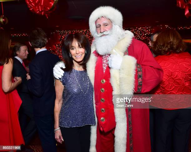 Wendy Carduner and Santa Claus attend A Christmas Cheer Holiday Party 2017 Hosted by George Farias and Anne and Jay McInerney at The Doubles Club on...