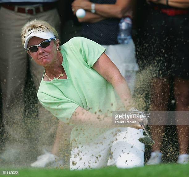 Wendy Doolan of Australia plays from a bunker on the 12th hole on her way to victory during the final round at The Evian Masters at Evian Golf Club...