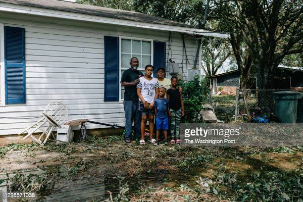 Wendy Evil and her fiance Kenneth Gibbes pose in front of their Wedgwood home with Evils grandchildren Bobbiana Lockhart Aykirah Ball and Akeviyan...