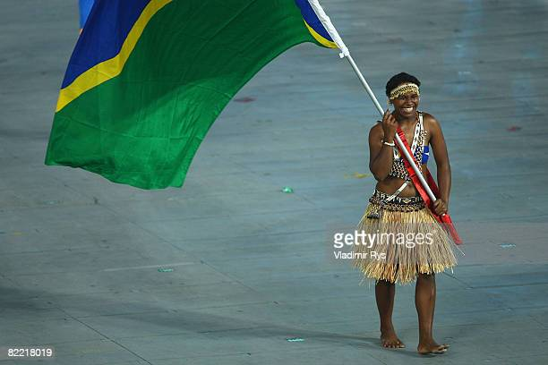 Wendy Hale of the Solomon Islands carries her nation's flag during the Opening Ceremony for the 2008 Beijing Summer Olympics at the National Stadium...