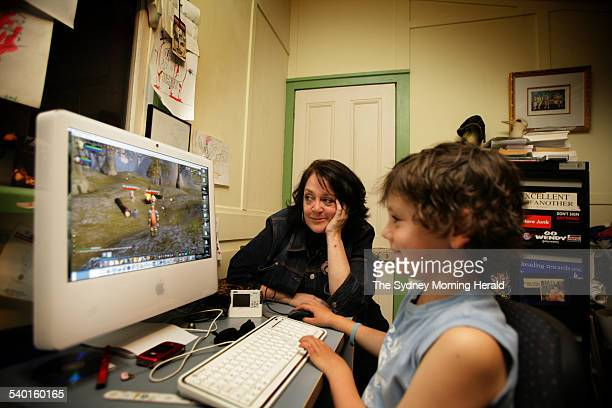 Wendy Harmer with her son Marley play the 'World of Warcraft' computer game at their Collaroy home, 25 October 2006. SMH Picture by SAHLAN HAYES