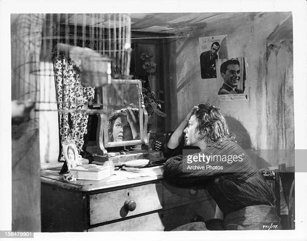 Wendy Hiller collapses in front of a mirror in a scene from the film 'Pygmalion', 1938.