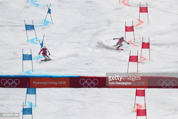 Wendy Holdener of Switzerland and Mariann Mimi Maroty of Hungary compete during the Alpine Team Event 1/8 Finals on day 15 of the PyeongChang 2018...