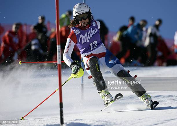 Wendy Holdener of Switzerland clears a gate during the first run of the Women's slalom at the FIS Ski World Cup on December 17 2013 in Courchevel...