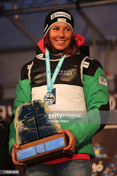 Wendy Holdener of Switzerland poses on the podium with the Janey Blair Trophy after winning the Womens Alpine Giant Slalom during day six of the...