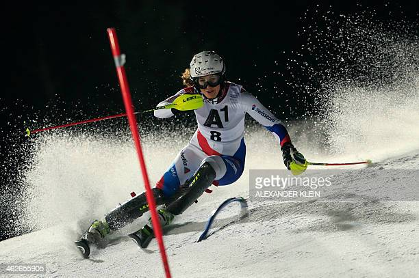 Wendy Holdener of Switzerland races down the floodlit slope during the first round of the slalom race of the FIS Ski World Cup in Flachau Austria on...