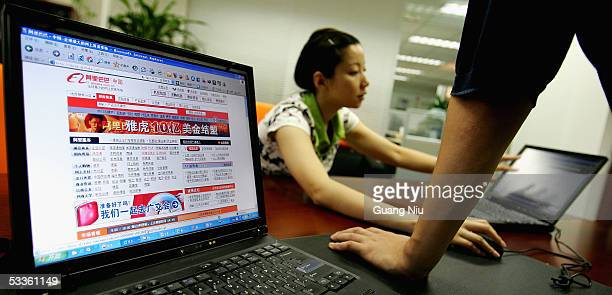 Wendy Li, vice director of business development department of Ali Baba works at the office of Alibaba technology Co., Lth on August 12, 2005 in...