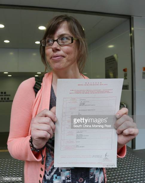 Wendy MorrowBlau shows certified copy of register of births for her son Kyuss Bradley MorrowBlau outside West Kowloon Office's Kowloon Births...
