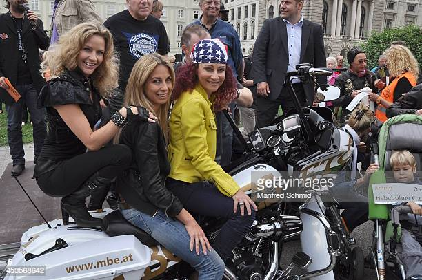 Wendy Night Yvonne Rueff and Christina Lugner pose for a photograph during the Harley Davidson Charity Tour 2014 Kick Off at Heldenplatz on August 13...