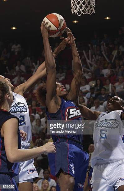 Wendy Palmer of the Detroit Shock goes up for a shot over Elaine Powell of the Orlando Miracle during the game at TD Waterhouse Centre in Orlando...