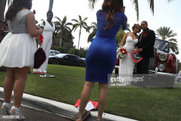 Wendy Ramirez and Anthony Moore pose for pictures after being married during a Valentine's day wedding ceremony at the National Croquet Center on...