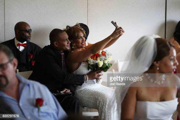 Wendy Ramirez and Anthony Moore take a selfie photo before taking part in the Valentine's day wedding ceremony at the National Croquet Center on...