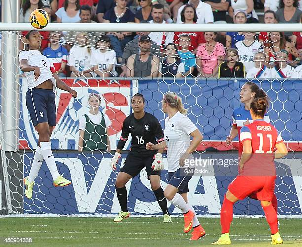 Wendy Renard of France keeps the ball from going into France's net as goalkeeper Sarah Boulhaddi of France watches during an international friendly...
