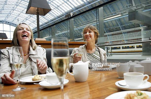Wendy Revitt and GIllian DilkeWing enjoy a champagne breakfast at St Pancras Station in London on September 12 2008 after they cancelled their trip...