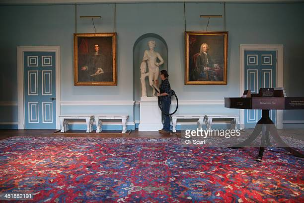 Wendy Richardson a member of the Conservation Team cleans the Entrance Hall of English Heritage's Kenwood House on the northern edge of Hampstead...