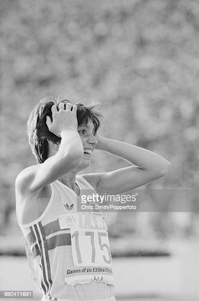 Wendy Sly of Great Britain puts her hands to her head in surprise as she finishes in second place to win the silver medal in the final of the Women's...