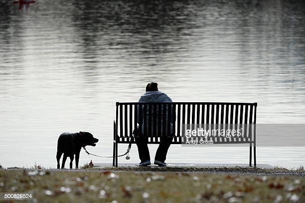 Wendy Vaerewyck and her dog Lexi take a break at Smith Lake in Washington Park in unseasonable temperatures December 10 2015 Photo by Andy Cross/The...