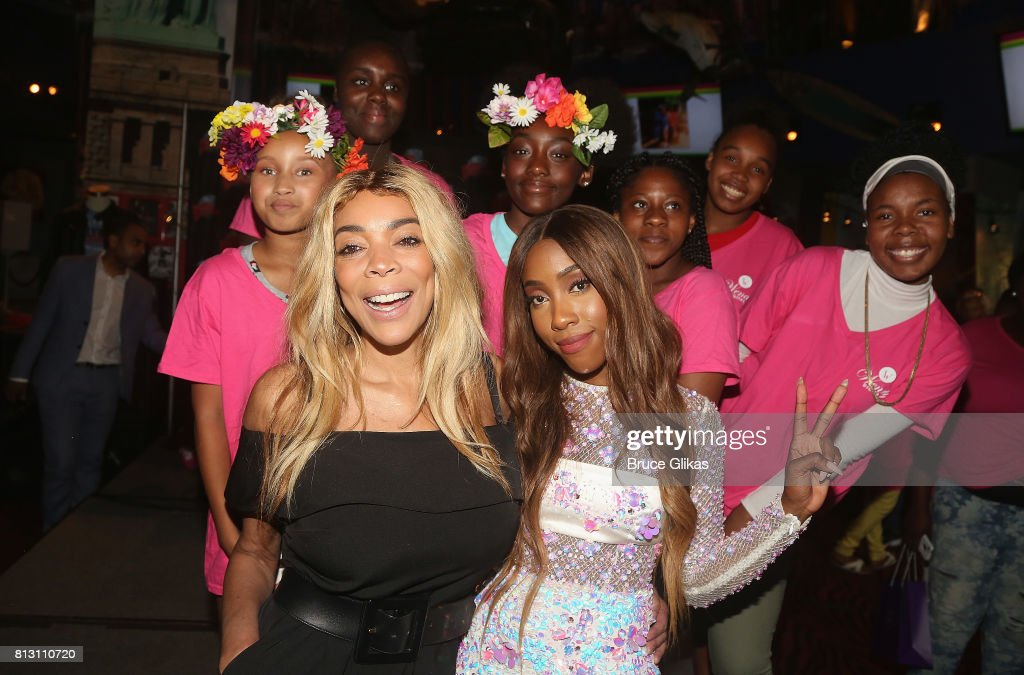 Wendy Williams and Sevyn Streeter pose with the kids at a celebration for The Hunter Foundation Charity that helps fund programs for families and youth communities in need of help and guidance at Planet Hollywood Times Square on July 11, 2017 in New York City.