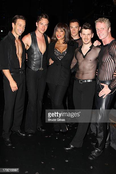 Wendy Williams poses backstage with the boys of the cast at the musical Chicago on Broadway at The Ambassador Theater on July 9 2013 in New York City