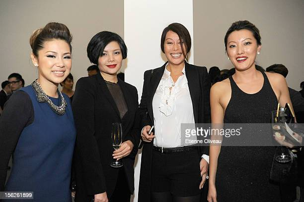 Wendy Yip Zou Yi Tian Kay de Baecque Rain Li pose for pictures during the Calvin Klein special dinner at the Long March Space in 798 Art District on...