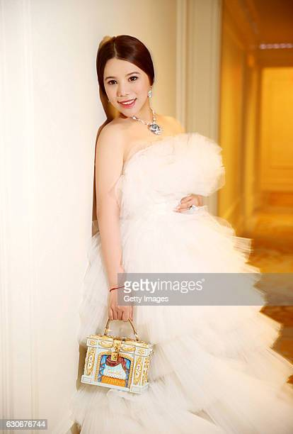 Wendy Yu attends the 62nd anniversary of the International Debutante Ball in the Grand Ballroom of The Pierre in New York City wearing a haute...