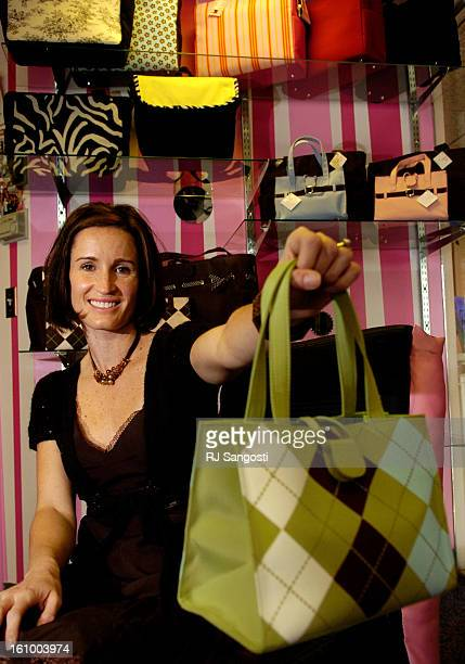 COLO NOV 10 2005 Wendy<CQ> Barry<CQ> from JP Lizzy designs handbags and diaper bags holds one of her bags Thursday Nov 10 2005 at the Pink Purse in...