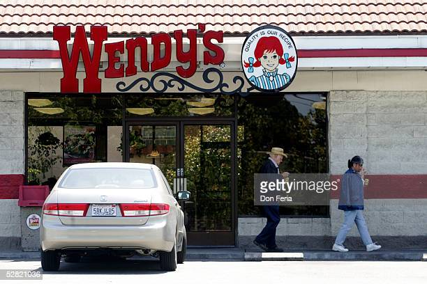 Wendy's patrons leave the Monterey Highway location May 13 2005 after the restaurant began to give free Frosty Dairy Desserts as a nationwide...