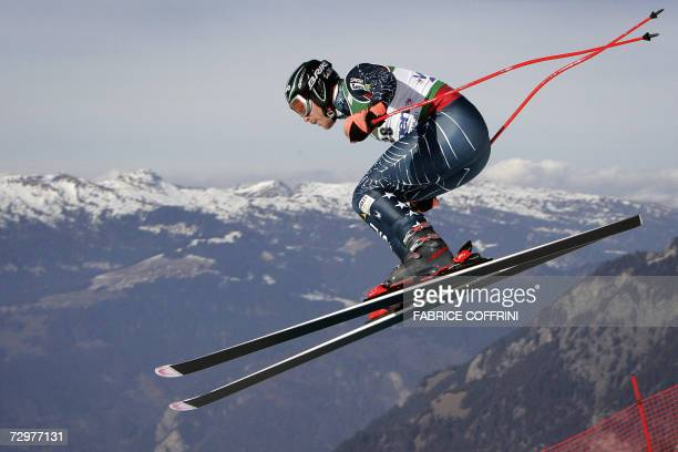 """Bode Miller of USA is airborn over the """"Russi jump"""" during the Lauberhorn men's ski World Cup downhill practice 11 January 2007 in Wengen. AFP PHOTO..."""