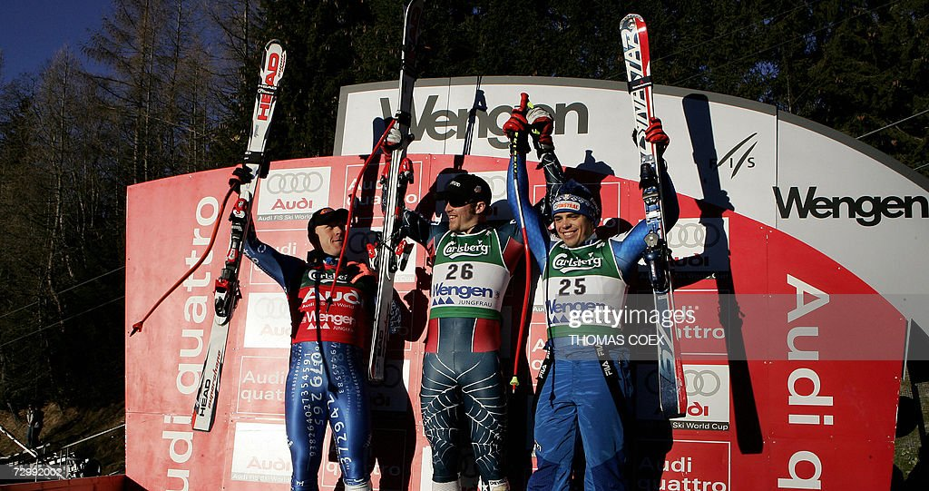 US Bode Miller (C), Switzerland's Didier Cuche (L) and Italy's Peter Fill (R) celabrate during the podium ceremony after winning the World Cup Alpine Skiing downhill race in Wengen, 13 January 2007. US Bode Miller won the race ahead of Switzerland's Didier Cuche (L) and Italy's Peter Fill (R).