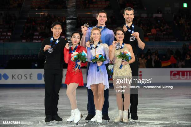 Wenjing Sui and Cong Han of China Aljona Savchenko and Bruno Massot of Germany and Meagan Duhamel and Eric Radford of Canada pose with thier medals...