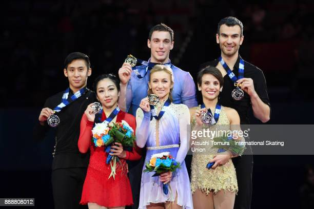 Wenjing Sui and Cong Han of China Aljona Savchenko and Bruno Massot of Germany and Meagan Duhamel and Eric Radford of Canada pose on the podium after...