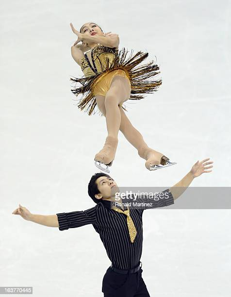 Wenjing Sui and Cong Han of China compete in the Pairs Free Skating during the 2013 ISU World Figure Skating Championships at Budweiser Gardens on...