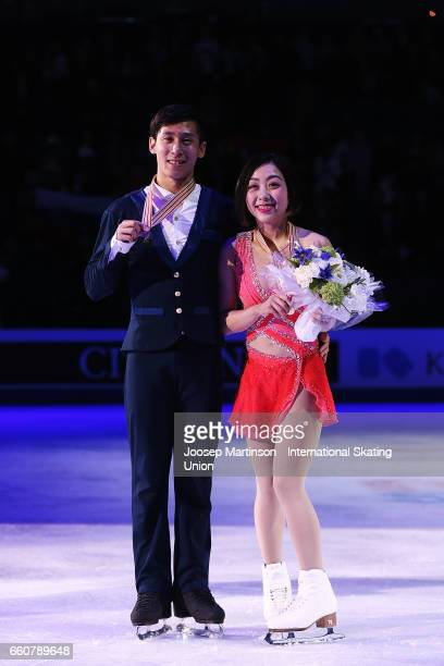 Wenjing Sui and Cong Han of China pose in the Pairs medal ceremony during day two of the World Figure Skating Championships at Hartwall Arena on...