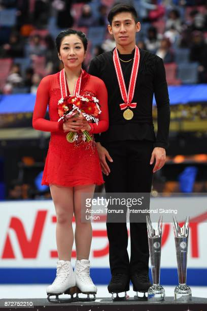 Wenjing Sui and Cong Han of China pose on the podium after winning the Pairs free skating during the ISU Grand Prix of Figure Skating at on November...
