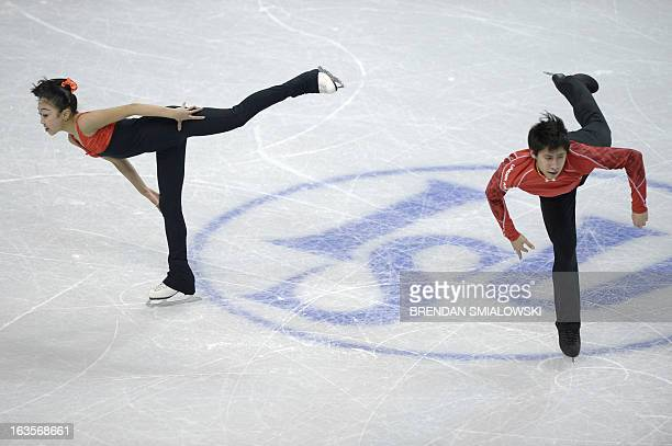 Wenjing Sui and Cong Han of China practice at Budweiser Gardens in preparation for the 2013 World Figure Skating Championships in London, Ontario, on...