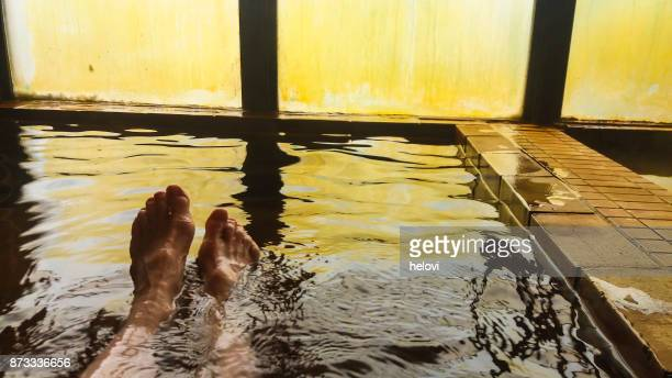 wenjoying hot spring water on hokkaido - hot spring stock pictures, royalty-free photos & images