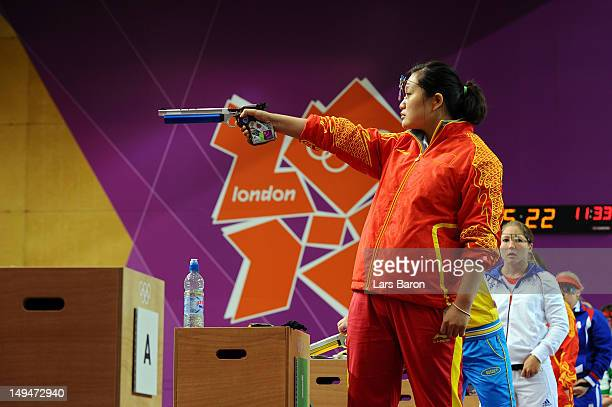 Wenjun Guo of China competes in the final of the Women's 10m Air Pistol Shooting on Day 2 of the London 2012 Olympic Games at The Royal Artillery...