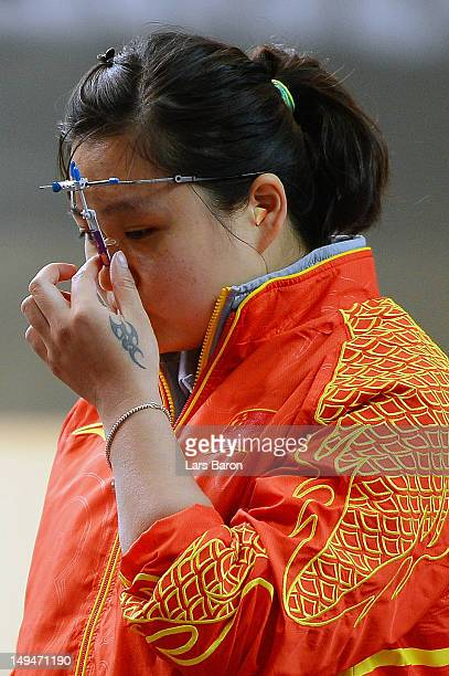 Wenjun Guo of China competes in the final round of the Women's 10m Air Pistol Shooting on Day 2 of the London 2012 Olympic Games at The Royal...