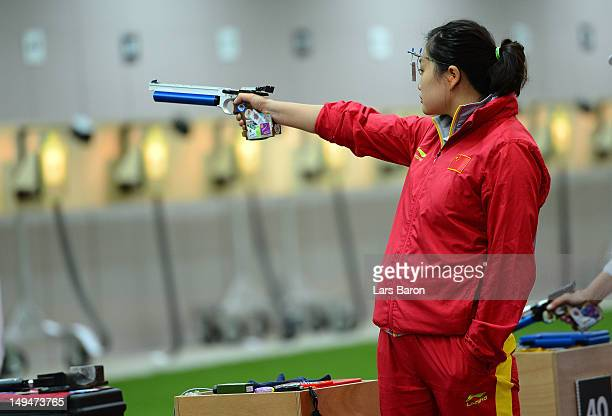 Wenjun Guo of China competes in the Women's 10m Air Pistol Shooting on Day 2 of the London 2012 Olympic Games at The Royal Artillery Barracks on July...