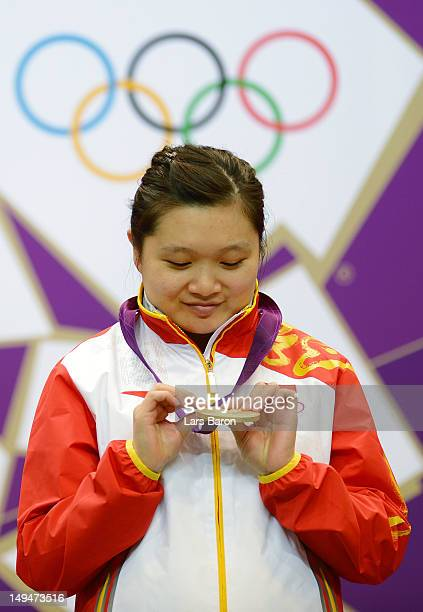 Wenjun Guo of China poses with her gold medal after the Women's 10m Air Pistol Shooting on Day 2 of the London 2012 Olympic Games at The Royal...