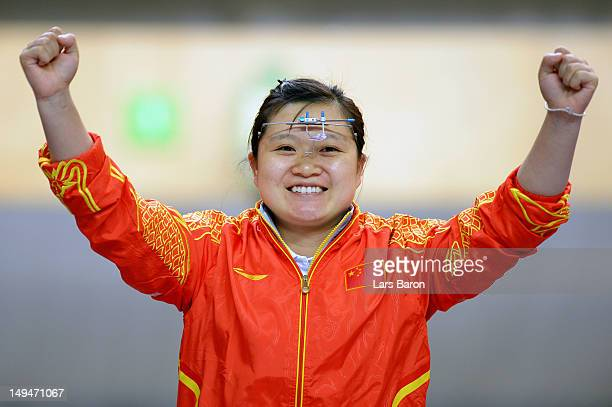 Wenjun Guo of China reacts after competing in the final round of the Women's 10m Air Pistol Shooting on Day 2 of the London 2012 Olympic Games at The...