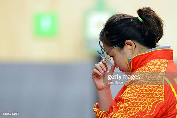 Wenjun Guo of China reacts competes in the final round of the Women's 10m Air Pistol Shooting on Day 2 of the London 2012 Olympic Games at The Royal...