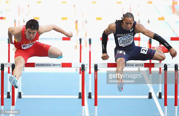 Wenjun Xie of China and Pascal MartinotLagarde of France compete in the Men's 110 metres hurdles heats during Day Two of the 14th IAAF World...