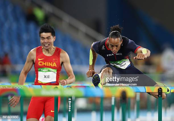 Wenjun Xie of China and Pascal MartinotLagarde of France compete during the Men's 110m Hurdles Round 1 on Day 10 of the Rio 2016 Olympic Games at the...