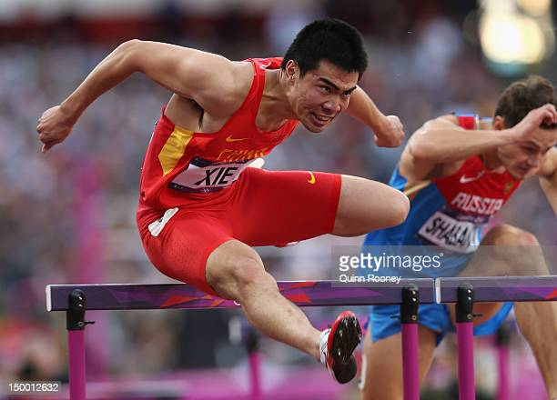 Wenjun Xie of China competes in the Men's 110m Hurdles Semifinal on Day 12 of the London 2012 Olympic Games at Olympic Stadium on August 8 2012 in...