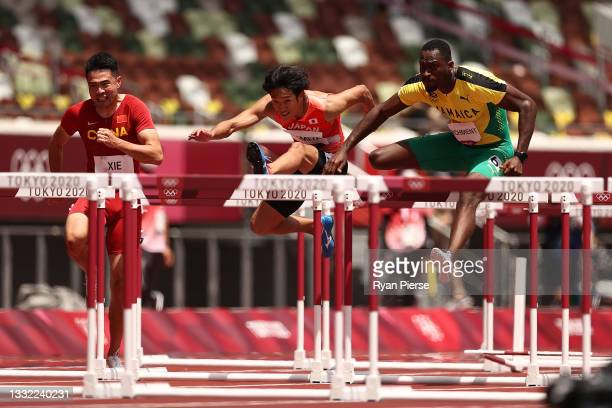 Wenjun Xie of Team China, Shunsuke Izumiya of Team Japan and Hansle Parchment of Team Jamaica compete in the Men's 110m Hurdles Semi-Final on day...