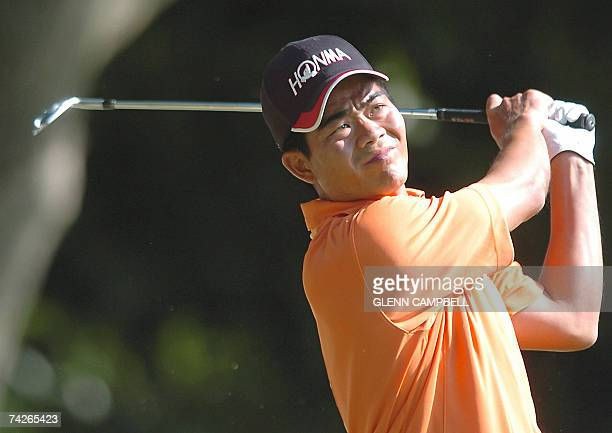 Golfer Wenchong Liang of China watches his tee shot as he plays in the first round of the BMW PGA Championship at the Wentworth Golf Club in Surrey...