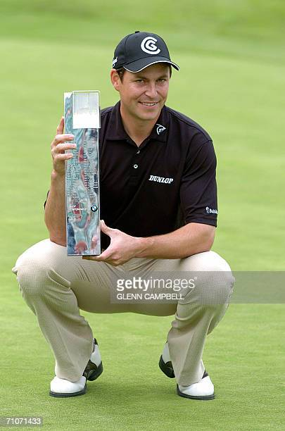 Wentworth, UNITED KINGDOM: Winner David Howell of England holds the European PGA-BMW Championship trophy at the Wentworth Club in Surrey, England, 28...